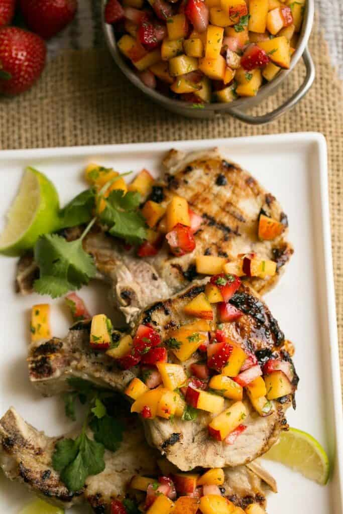My contributor Sara is sharing her recipe for Pork Chops with Strawberry Peach Salsa- Love, Pasta and a Tool Belt | recipes | dinner | grill | grilling | recipe ideas | pork chops | salsa |