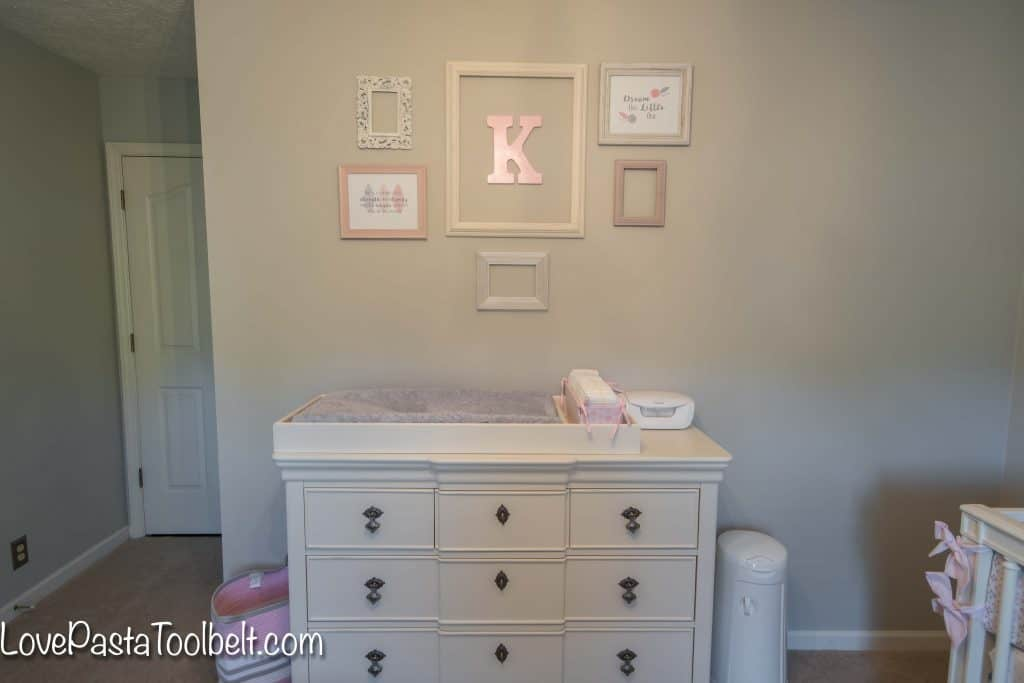 A gallery wall is a great way to dress up a blank wall. We created a gallery wall for K's nursery and I'm sharing Easy Steps to Create a Nursery Gallery Wall. #ad #GooGone #GoodAsGone