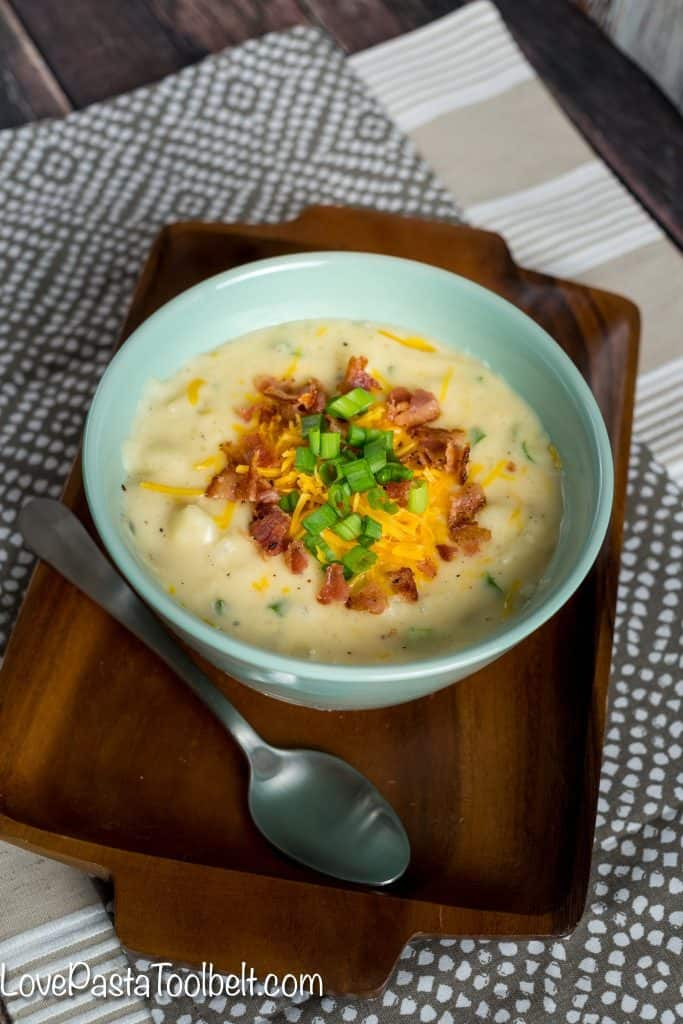 Warm up with a bowl of this delicious Creamy Baked Potato Soup. No chopping or peeling of potatoes required! Just a little prep for a delicious dinner!