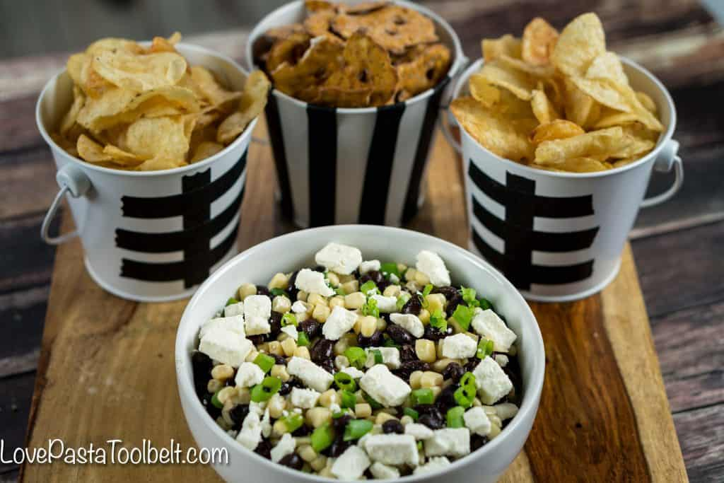 Football season is in full gear and hosting can be stressful. Take some of the stress out with this simple Black Bean Salsa and cute Football Themed Snack Pails for your next party!