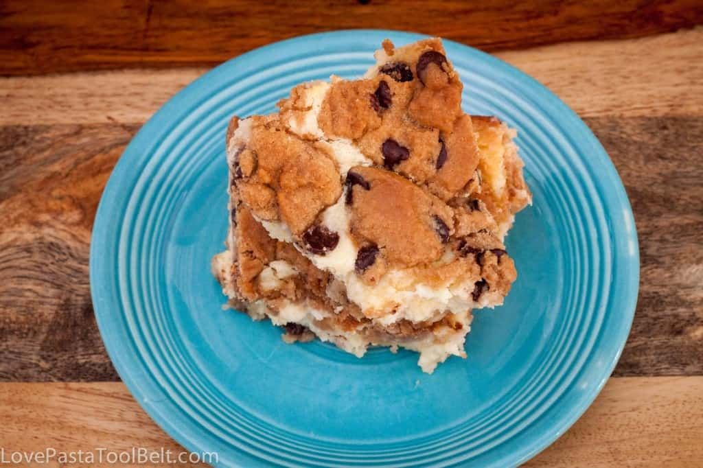 This Chocolate Chip Cookie Cake is filled with a delicious cream cheese mixture. It is easy to make and the perfect dessert- Love, Pasta and a Tool Belt