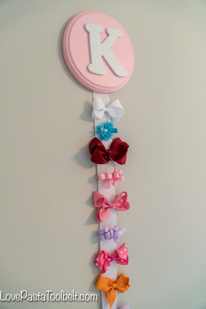 Create a cute and functional way to display your little girl's bows with this DIY Bow Holder