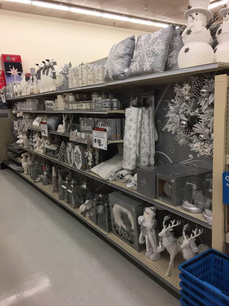Starting Christmas decorating? Get inspired with this Silver and White Christmas Mantle!
