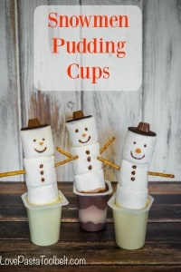 Add some fun to your pudding with these Snowmen Pudding Cups!- Love, Pasta and a Tool Belt #SnackPackMixins #ad   Desserts   Christmas   Treats   Dessert Ideas  