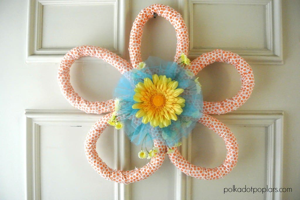 My guest poster Dru is sharing her beautiful DIY Spring Flower Wreath. It's the perfect craft project to decorate your front door. Click thru for the tutorial or Repin to save for later!